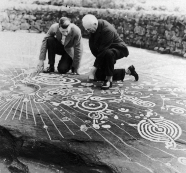 Ludovic Maclellan Mann examining the Cochno Stone